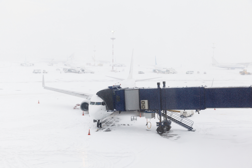 plane on snow covered runway